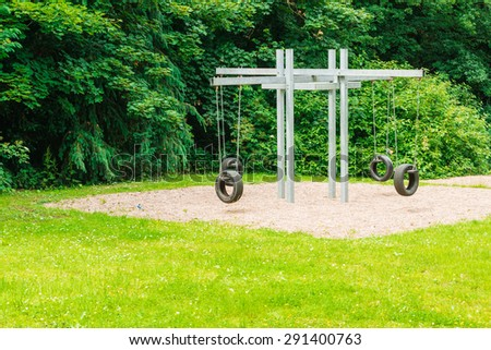 Playground with swings middle of the park - stock photo