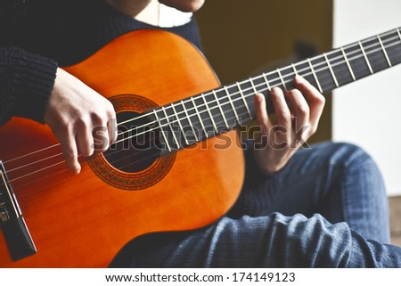 playing a classic guitar - stock photo