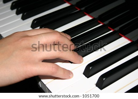 Playing a Grand Piano - stock photo
