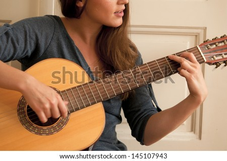 Playing a guitar - stock photo