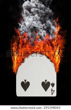 Playing card with fire and smoke, isolated on white - Four of spades - stock photo