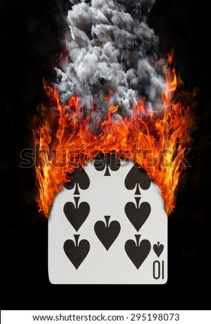 Playing card with fire and smoke, isolated on white - Ten of spades - stock photo