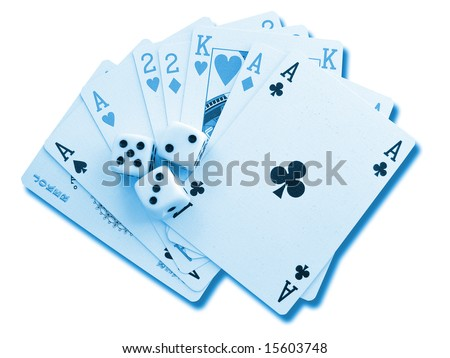 Playing cards and accessories on a background - stock photo