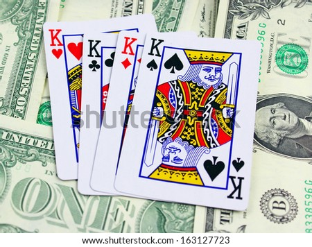 Playing cards and dollars - stock photo