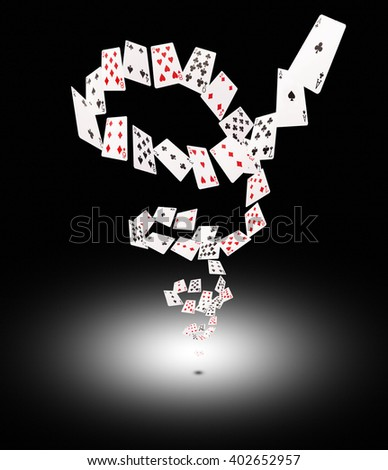 Playing cards flying at the poker table. - stock photo