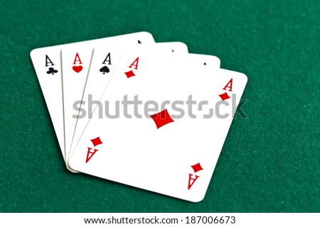Playing cards on a green background. Poker of aces - stock photo