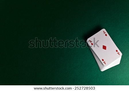 playing cards on green table in cacino - stock photo