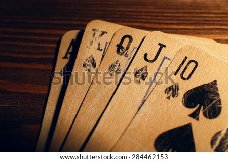 Playing cards on wooden table, closeup - stock photo