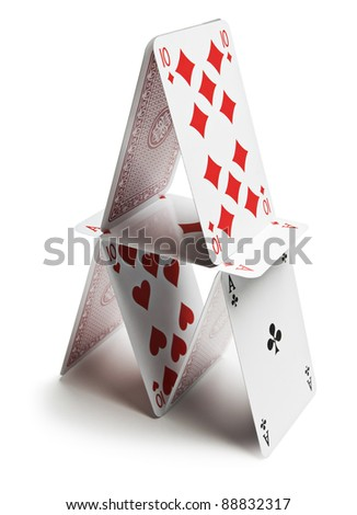 Playing cards pyramid isolated on white close up - stock photo