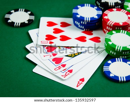 Playing cards show royal flush in poker game - stock photo
