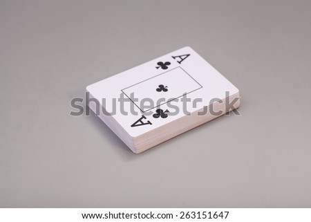 Playing cards with ace of clubs isolated on gray background - stock photo
