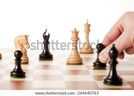Playing chess game - moving the black pawn - stock photo