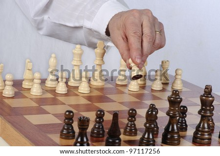 Playing chess - opening move - stock photo