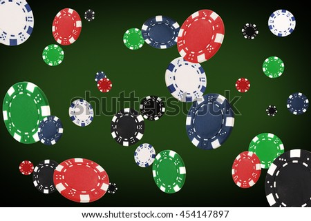 Playing chips flying at the poker table. - stock photo