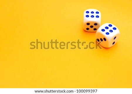Playing cubes on cloth. - stock photo