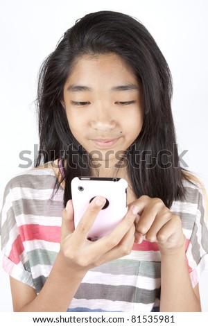 playing games, Asian teen girl playing game on smart phone. - stock photo