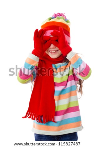 Playing girl in winter clothes looking through imaginary binocular, isolated on white - stock photo