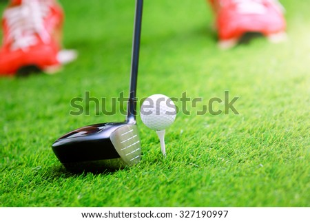 Playing golf - shot of golf ball with golf club - stock photo