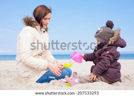 playing in the northsea or eastsea in colder times - stock photo