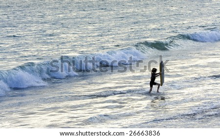 Playing in the Ocean Waves - stock photo