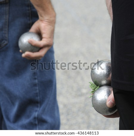 Playing jeu de boules or also called petanque in France. This play is played at street in every village of France. Selective focus at right balls. - stock photo