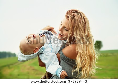 playing mother and baby. Mom and son - stock photo
