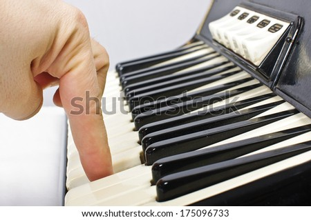 Playing on accordion keyboard - stock photo