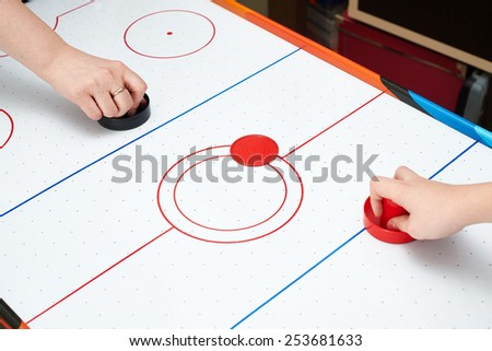 Playing on air hockey at home - stock photo