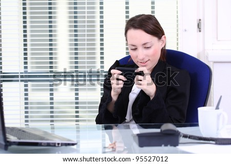 Playing on mobile phone/ unreliable - stock photo