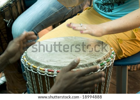 playing on the african drum, music festival - stock photo