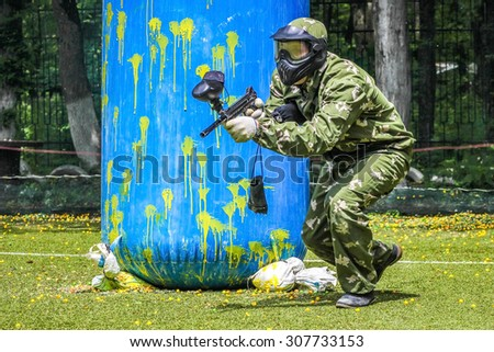 Playing paintball - stock photo