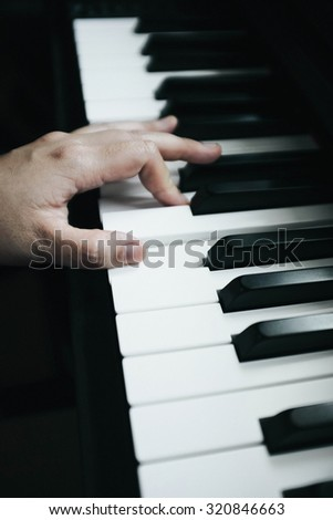 Playing Piano, Pianist Hand. Selective Focus Shot, Vintage Tone. - stock photo
