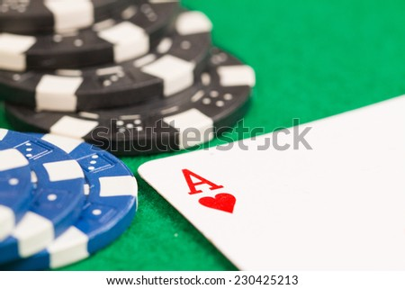 Playing Poker Chips and Ace Card Green Background Close-up - stock photo