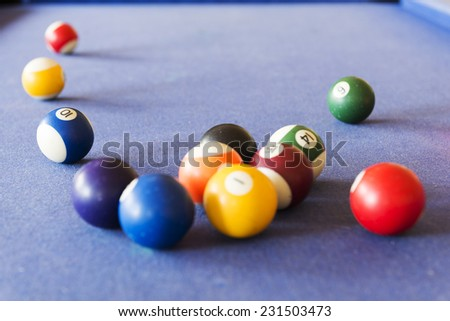 Playing pool on a pool table with billiard balls - stock photo