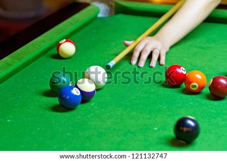 Playing pool on green table - stock photo