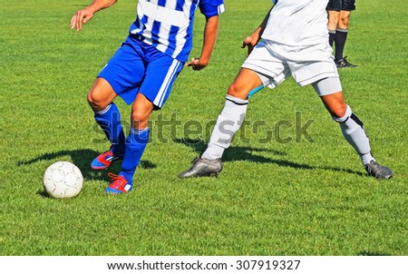 Playing soccer - stock photo