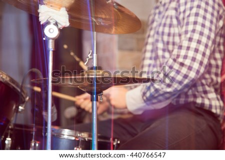 playing the drum set - stock photo