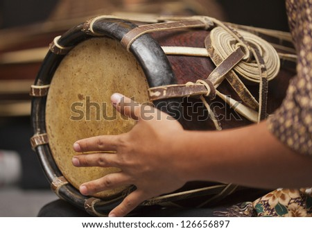 Playing the Thai java drum - stock photo