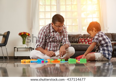 Playing with dad - stock photo