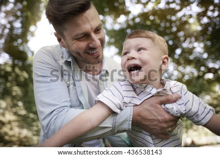 Playing with daddy always are interesting - stock photo