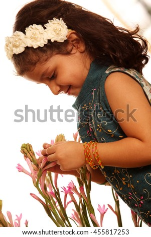 Playing with Flowers - stock photo