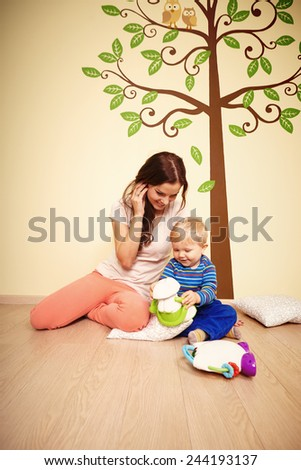 Playing with son at home - stock photo