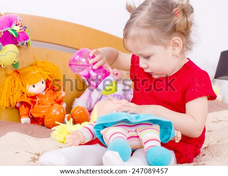 Playing with the doll girl  - stock photo