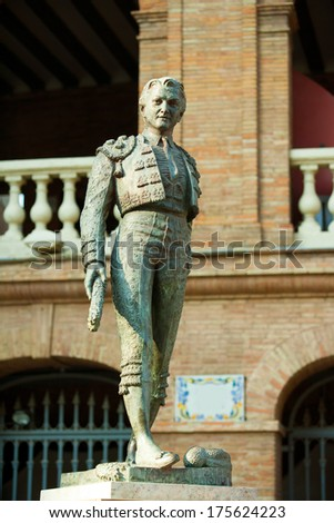 Plaza de toros de Valencia bullring with toreador statue of Manolo Montoliu - stock photo