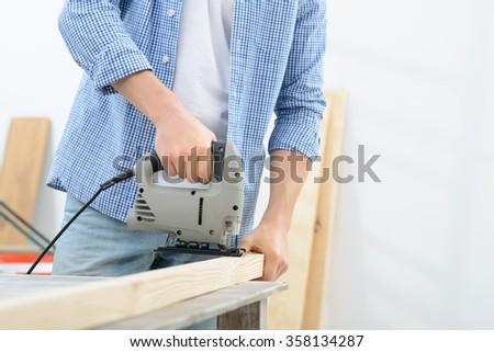 Pleasant man doing renovation  - stock photo