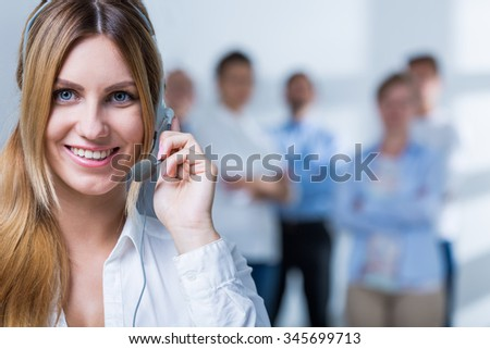 Pleasant telemarketer has very good results in the work  - stock photo