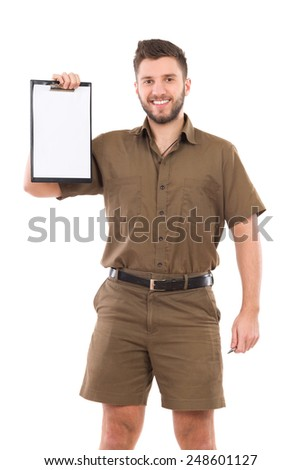 Please confirm your delivery. Happy courier showing a clipboard. Three quarter length studio shot isolated on white. - stock photo