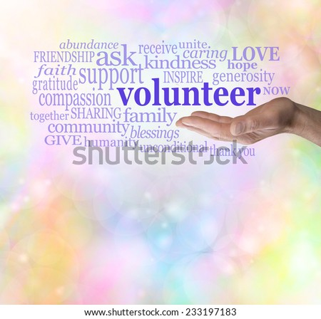 Please volunteer bokeh background  -  Male hand palm up with the word 'volunteer' floating above surrounded by relevant words on a rainbow colored bokeh background                            - stock photo