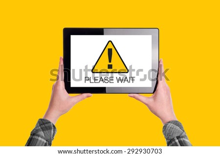 Please Wait Message on Digital Tablet Computer Display, Woman Holding Device, Isolated on Yellow Background - stock photo