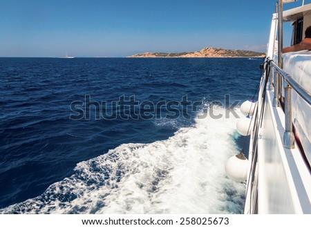 Pleasure boat cruising in the sea - stock photo
